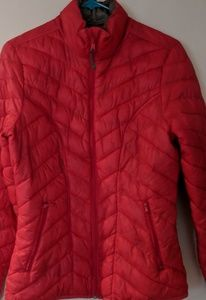 Bright salmon colored puffer jacket